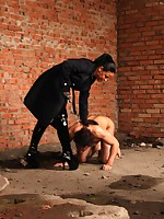Fascinating strict brunette mistress beating her recalcitrant slave up