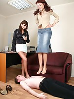 Dom girlfriends use their office to play trampling games with a clerk