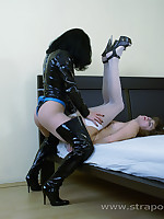 Latex mom fucks the shit out of little stockinged doll's ass with strap-on