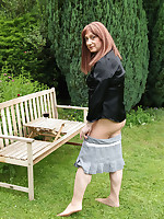 Lucimay is having some outdoor fun as she pulls down her mini skirt and plays with her big cock.