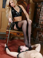Miserable slave gets a strapon fuck for licking Mistress clean